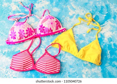 many different swimsuits.  Bright summer style