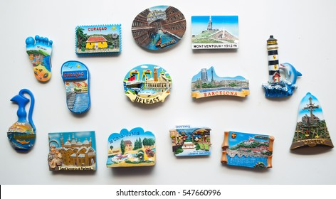many different travel magnet souvenirs on the fridge