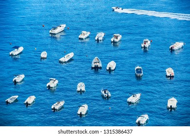 Many different type of small boats at port of Scilla, Calavbria, Italy