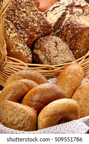 Many different types of bread and rolls in wicker basket