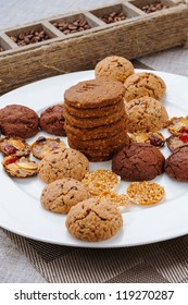 many different types of cookies lay on a plate