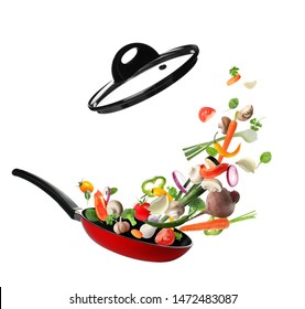 Many different vegetables falling into frying pan on white background