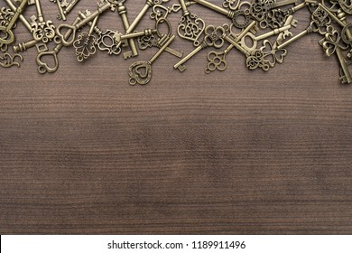 many different vintage keys concept on wooden background with copy space