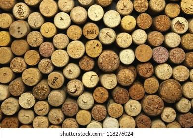 many different wine corks in the background