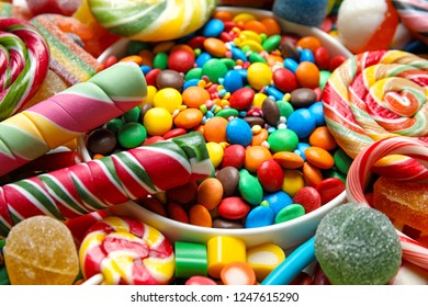 Many different yummy candies as background, closeup