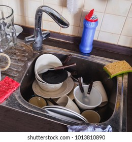 Many dirty dishes in kitchen matea sink.