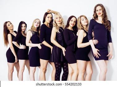 Many diverse women in line, wearing fancy little black dresses,