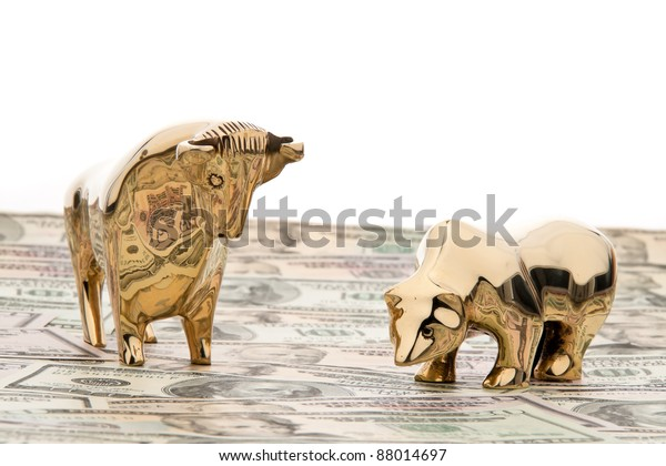 many dollar bills with bull and bear, symbol for stock exchange