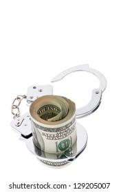 many dollar bills with handcuffs