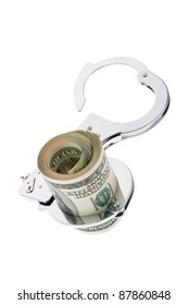 many dollar bills with handcuffs on white background