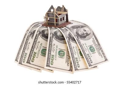 Many dollars bills and shell house