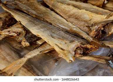 Many dried fish called stockfish for sale at european market