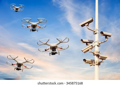 Many drones flying against the blue sky.