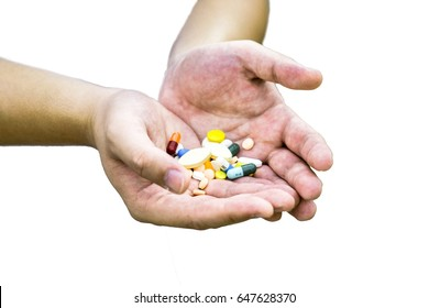 Many drug ,pill, capsule which are held  in  both hands isolated on white background