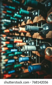 Many dusty wine bottles are on the shelves,Racks of wine bottles