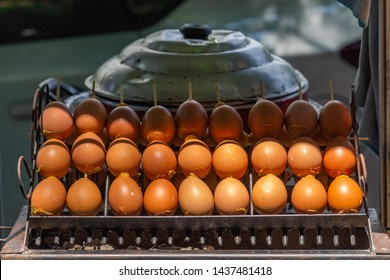 Many eggs exposed on a street food stall in Bangkok, Thailand