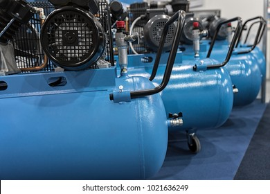 Many electric compressors lined up in garage