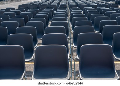 Many empty chairs without audience detail