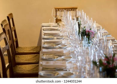 Many empty wine glasses on the table.