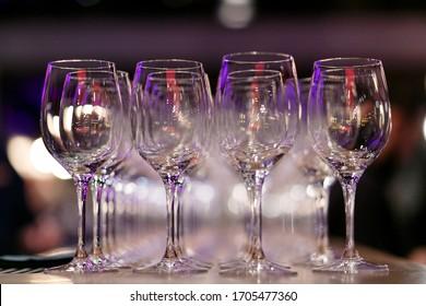 many empty wineglasses in bar