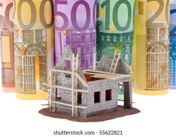 Many Euro bank notes with shell house