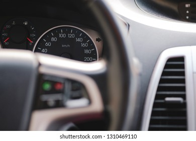 Many extra, modern car interior, close-up of dashboard, speedometer.