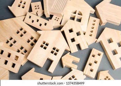 Many felled wooden houses. Destruction of houses as a result of natural disaster. The flood. Hurricane. Fire. Danger. Emergency housing. Reconstruction of old buildings. Evacuation of residents