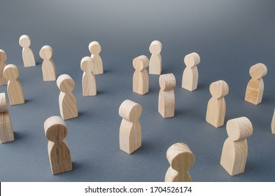 Many figures of people stand at a distance. People Society Concept. Behavior and social science relationships. Manipulation and management. Marketing, segmentation, consumer market research.