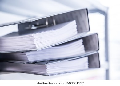 Many file folders on the shelf represent a large amount of data storage for searching. Or data collection for research studies.