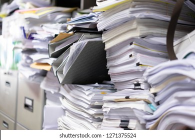 Many filing cabinets in a messy office without mess on bad work.