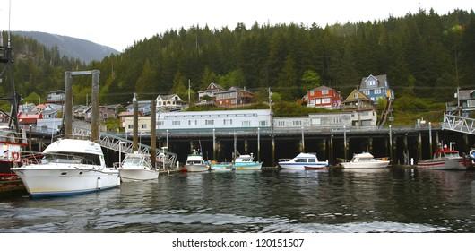Many fishing boats docked at a harbor in Alaska