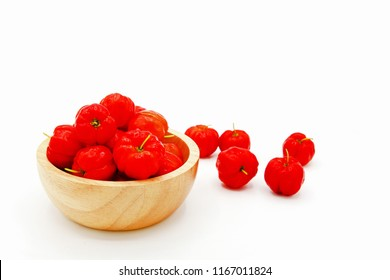 Many fresh cherry Acerola, Barbados Cherry, West Indian Cherry or Wild Crapemyrtle in wooden bowl isolated on white background-Freshness fruit and Organic concept. Scientific name: Malpighia emarginat