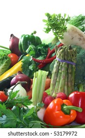 many fresh, different types of vegetables stacked in a pile