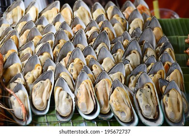 many fresh oyster on fire
