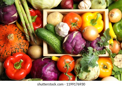 Many fresh ripe vegetables as background. Organic food