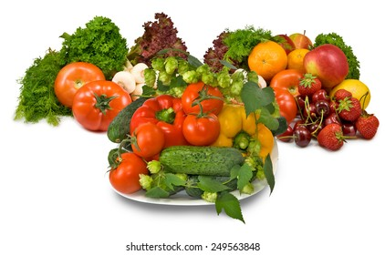 many fresh vegetables and berries on a plate closeup