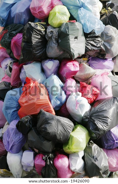 Many Garbage Plastic Bags With Different Colours Piled Up