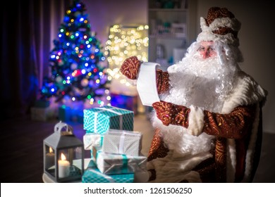 Many gifts and a Christmas tree.. Santa Claus reads the list of those who are waiting for gifts from him.