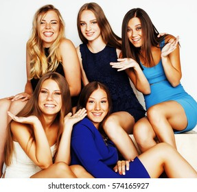 many girlfriends hugging celebration on white background, smilin