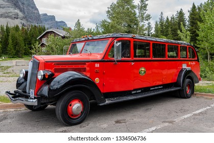 Many Glacier, Glacier Natoinal Park, United States: June 29, 2018: Parked Red Jammer . These red long busses provide historical tours through Glacier National Park in northern Montana.