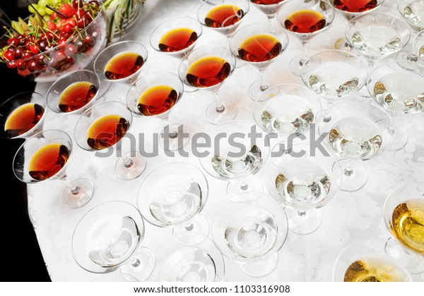 Many glasses of colorful Cocktails on the table