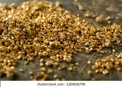 Many gold nuggets on table