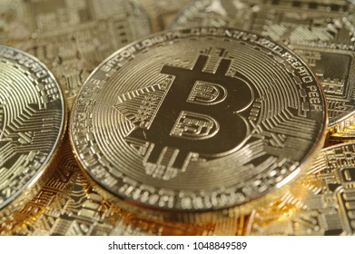 Many golden bitcoins as conceptul crypto currency image
