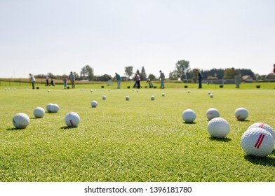 Many golf balls on exercise area on golf course