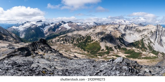 Many Great Peaks of the Glacier Peak Wilderness stretch ascross the horizon in this large panoramic vista. Cascade Mountains, Washington