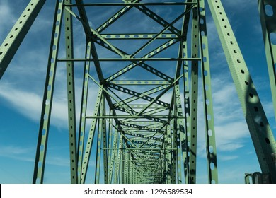 Many green metal beams of the Astoria - Megler Bridge  Bridge in Astoria, Oregon, USA.