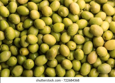 Many green olives as background