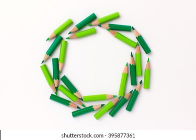 Many green pencils forming a circle