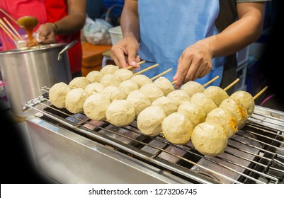 Many grilled big meat balls at night market street food festival of Thailand.