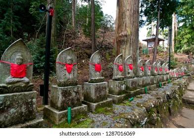 "Many guardian deities of children in Muro-ji Temple of Nara. These stone statues are called ""jizo""."